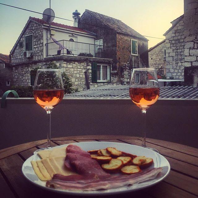 Wine & Dalmatian plate on our balcony in Split